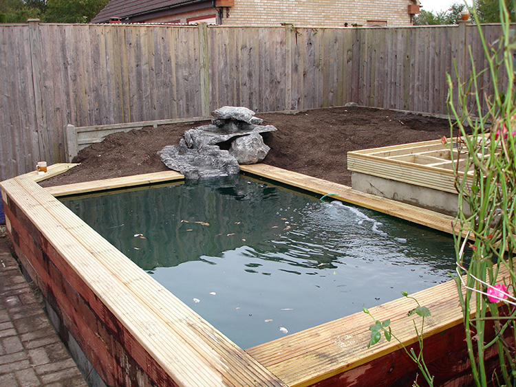 Raised pond construction stanstead abbotts aqua maintenance for Wooden koi pond construction